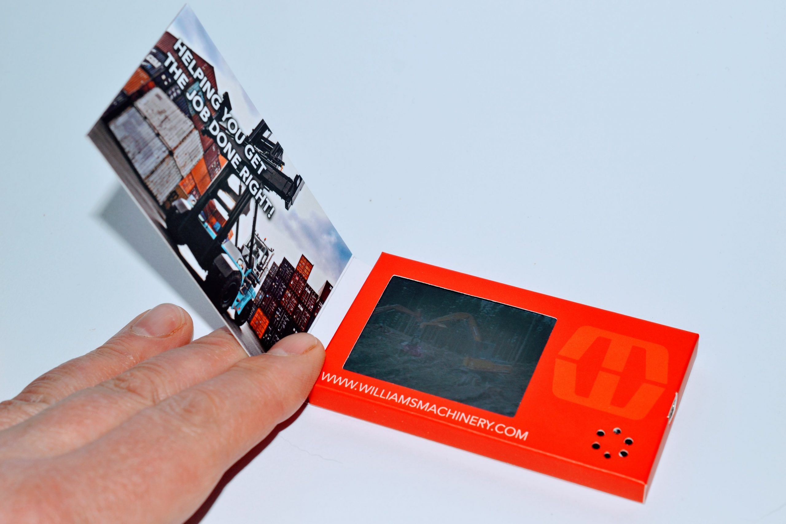 LCD business card in a person's hand