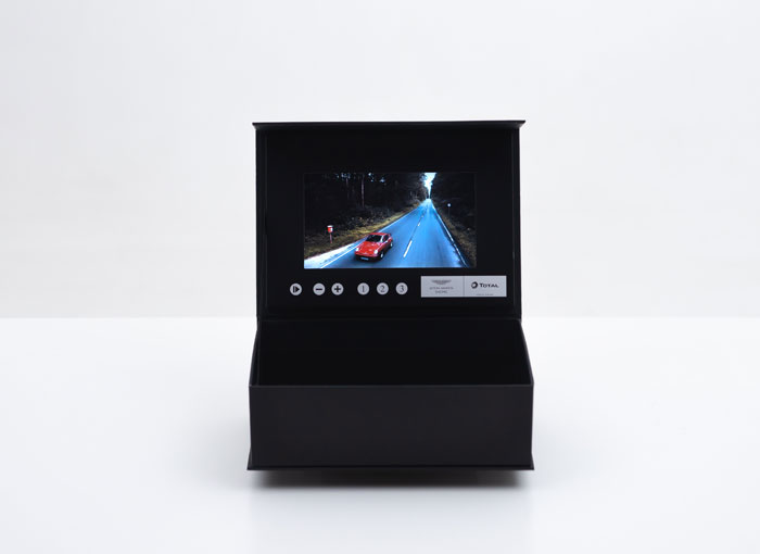 video box with open lid and screen showing a movie
