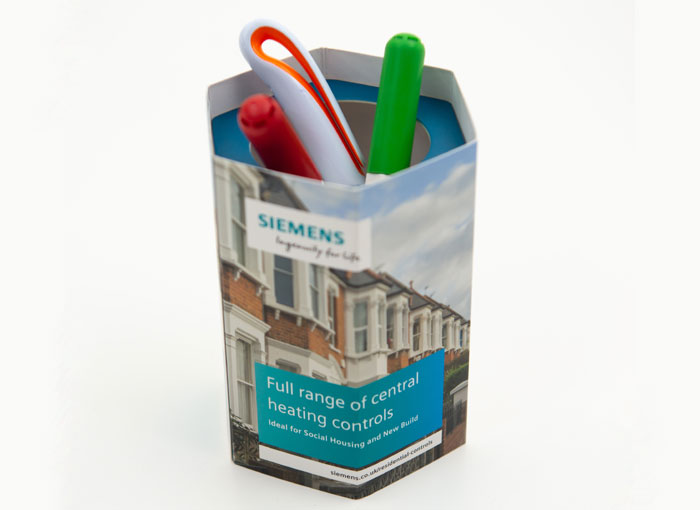 pop-up desk tidy with pens inserted