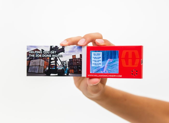 LCD business card pictured in a person's hand