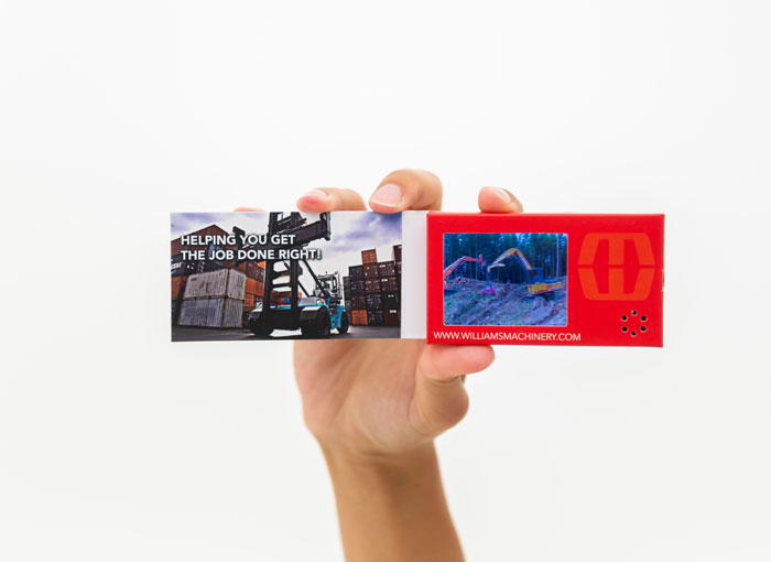 LCD business card held in someone's hand